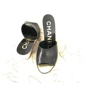 Chanel mules.